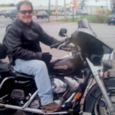 Bill Sloan on motorcycyle