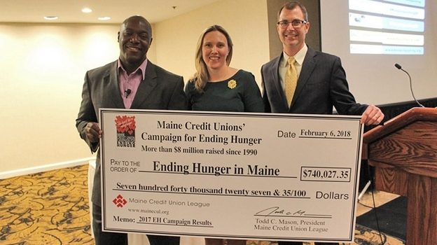 Maine Credit Union League with giant check
