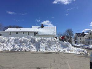 Snow plie outside the Dirigo Drive branch.